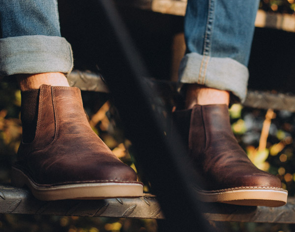 casual chelsea boots worn with blue jeans