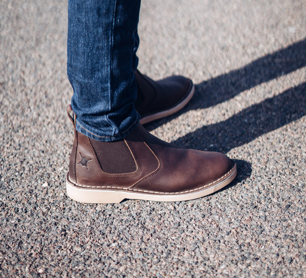 leather chelsea boot on road
