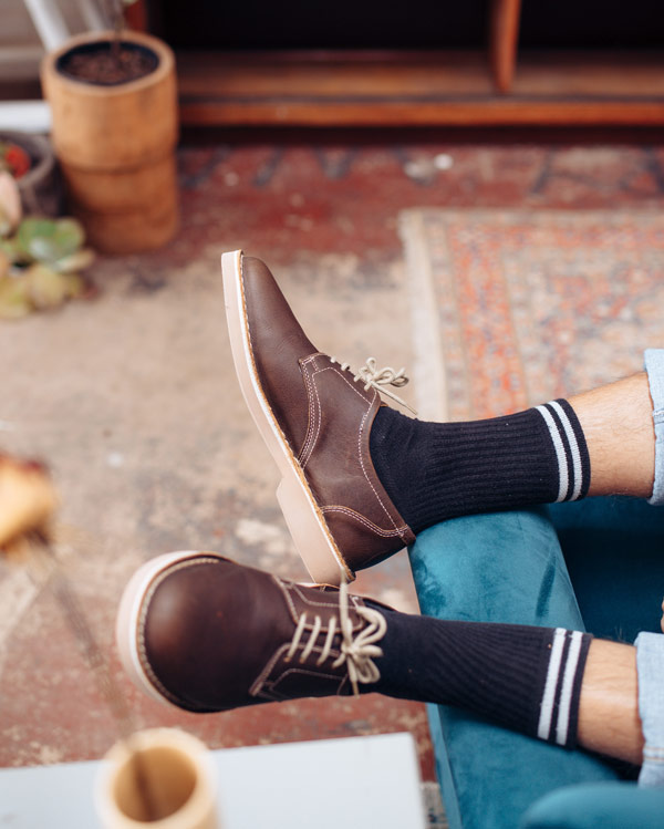 brown leather shoe with black sox