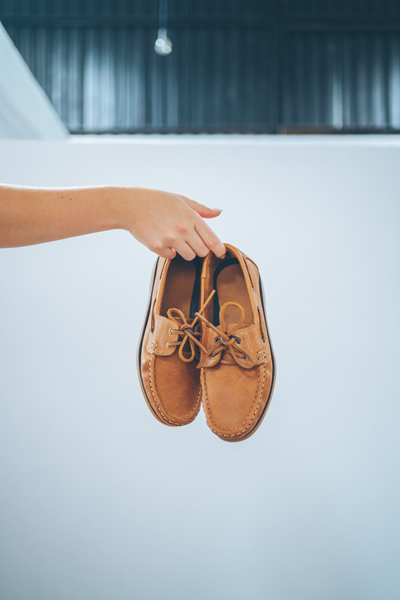 person holding legion moccasin shoes