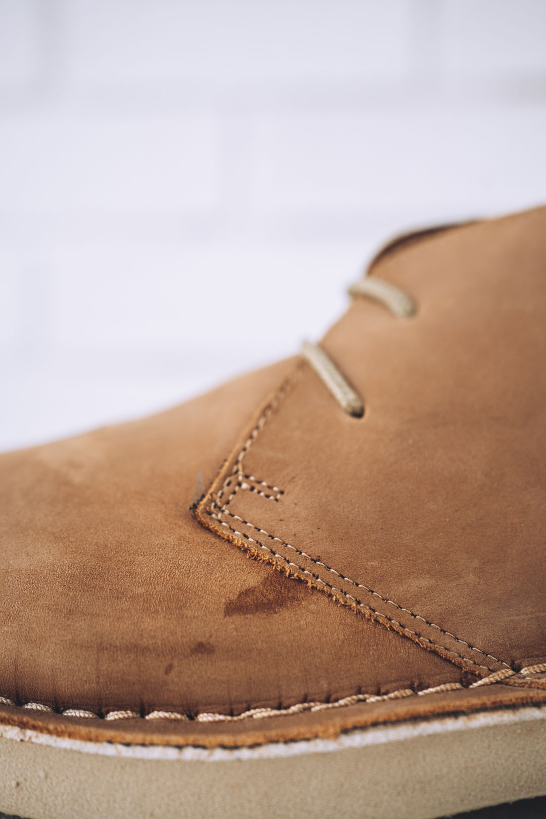 ankle boot with factory glue and needle mark