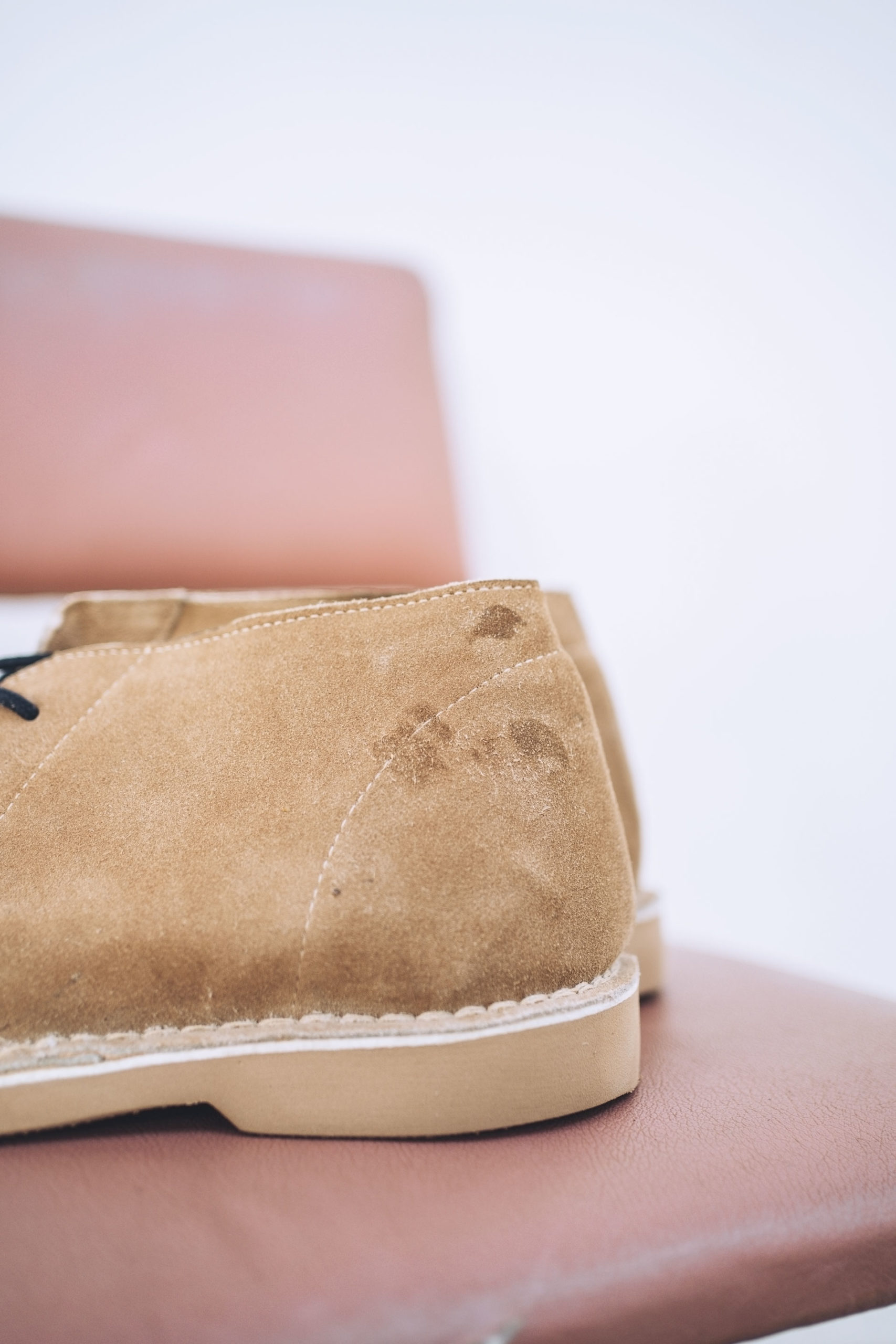 Leather boots with glue blemishes